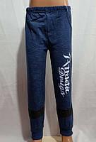 Спортивные штаны для мальчика на 4-7 лет синего цвета на манжете с надписью оптом