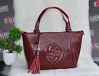 Бордовая женская кожаная сумка Гуччи.