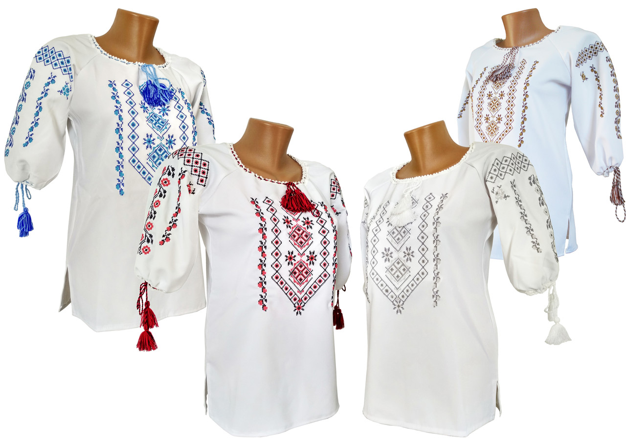 Красива жіноча вишиванка із геометричним орнаментом у білому кольорі тканини «Мадонна»