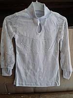 Гольф-блузка для девочки на 5-8 лет белого цвета с кружевом оптом