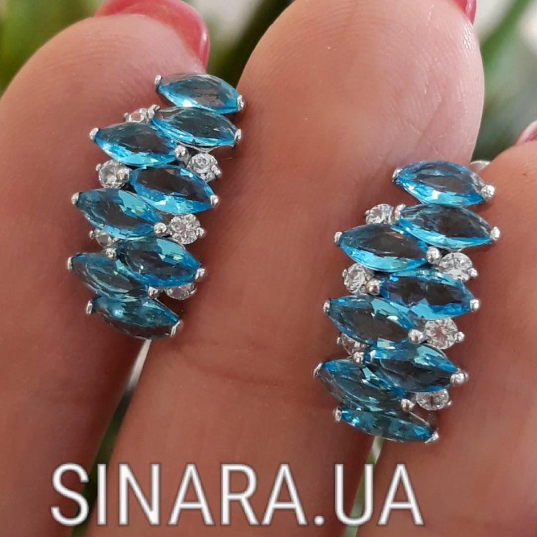 Серебряные серьги с голубыми фианитами под топаз