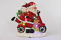 Декоративная музыкальная статуэтка Санта на мопеде с LED-подсветкой 19см (2 режима - подсветка и подсветка с музыкой)