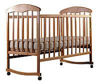 Кровать НАТАЛКА ольха светлая опускаемой боковиной, с качалкой на полозьях и съемными колесами.