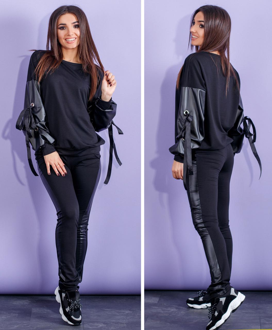 Черный спортивный костюм с объемными кожаными рукавами и лампасами
