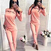 Жіночий спортивний костюм зі шнурівкою на грудях персиковий