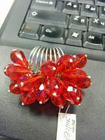 Необычное кольцо с красными кристаллами