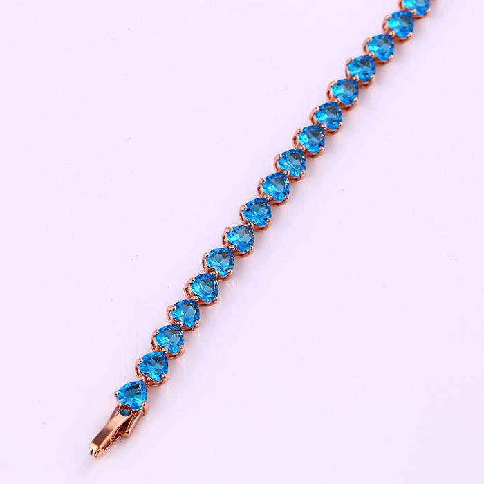 Богатый браслет с фианитами аквамарнового цвета