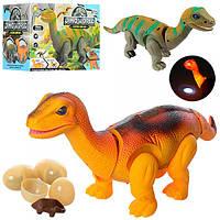 Динозавр 666-3A  38см,ходит,зв,свет,проектор,несет яйца(3шт),2цв,на бат,в кор-ке,19-11,5-14см