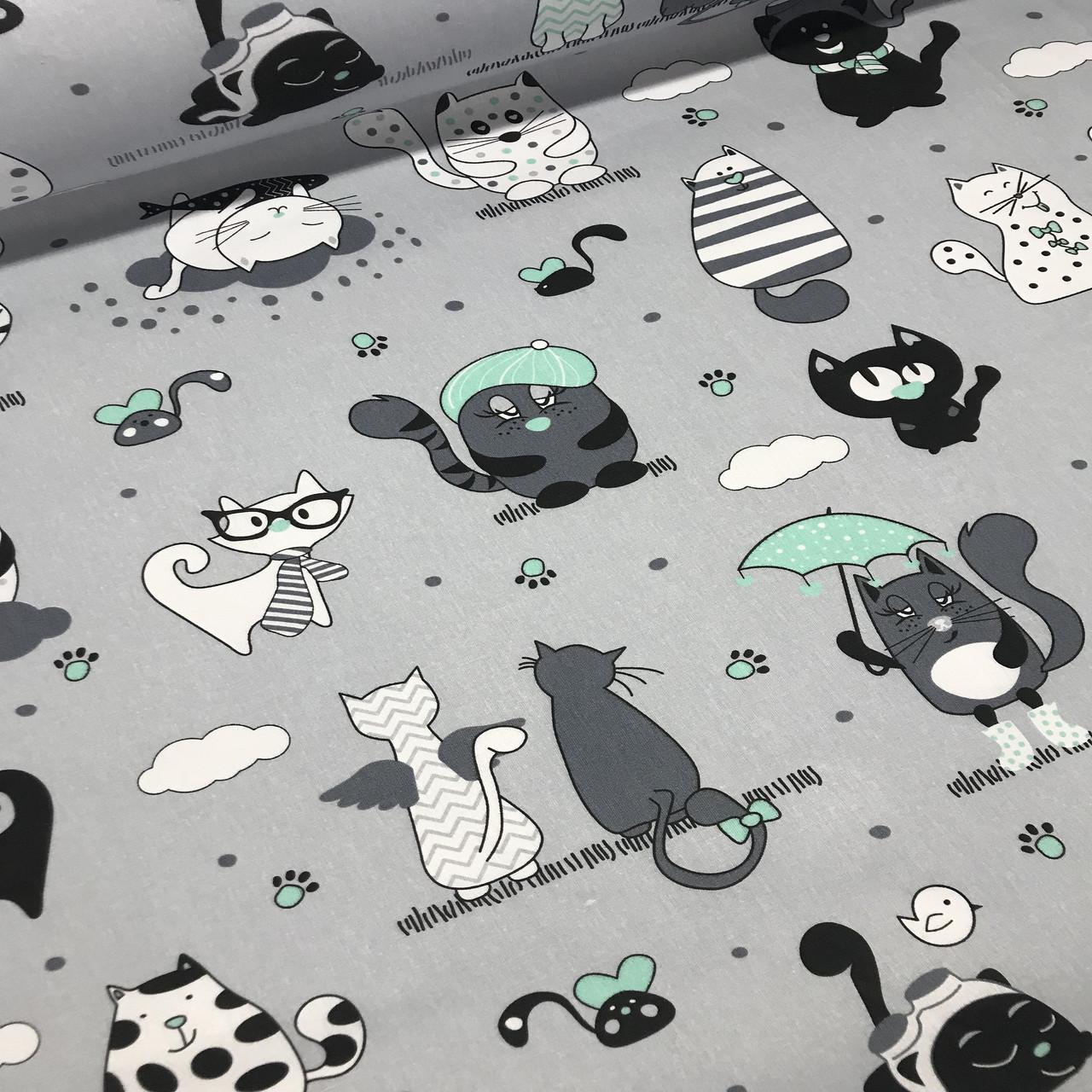 Хлопковая ткань польская коты серые и белые, с мятными зонтиками и мятными лапками на сером №44