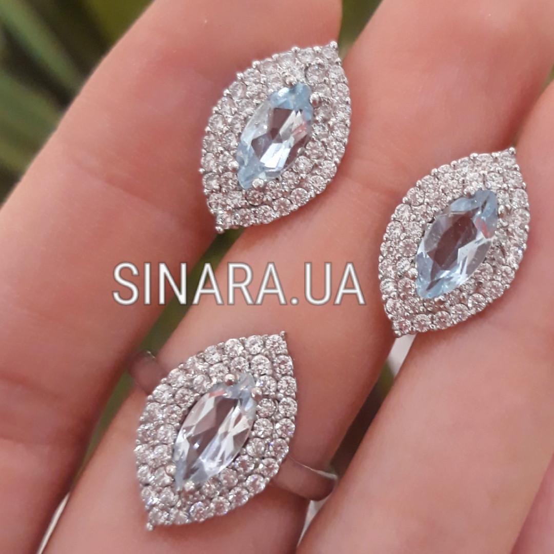 Серебряный комплект: серьги и кольцо с голубым топазом
