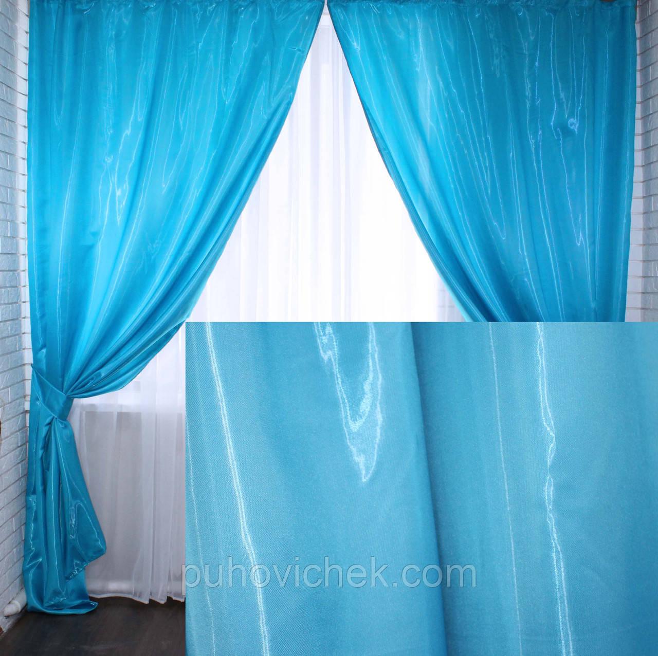 Плотные  шторы для спальни голубого цвета