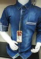 Рубашка джинсовая на мальчика 4-8 лет с длинным рукавом синего цвета оптом