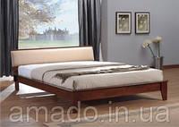 Скидка 23 % на деревянную кровать с мягким изголовьем.