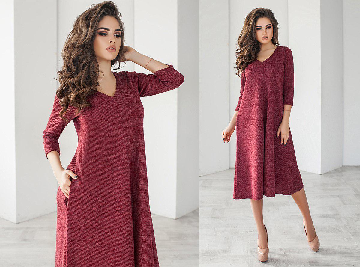 Платье ниже колен с карманами