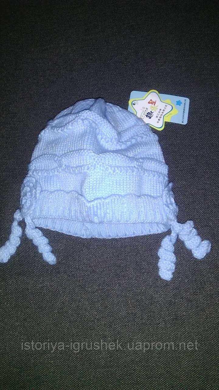 Красивая весенняя вязанная шапочка для новорожденного