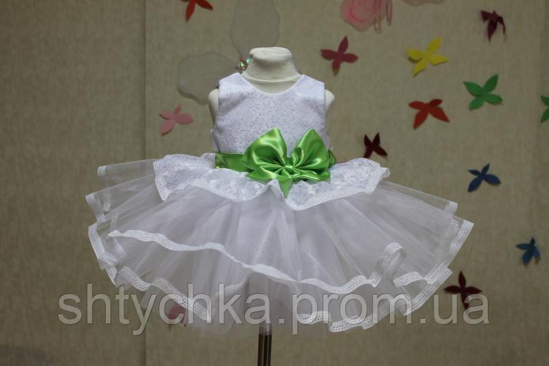 """Нарядное платье на девочку """"Карамелька"""" в белом цвете с салатовым поясом и бантом"""