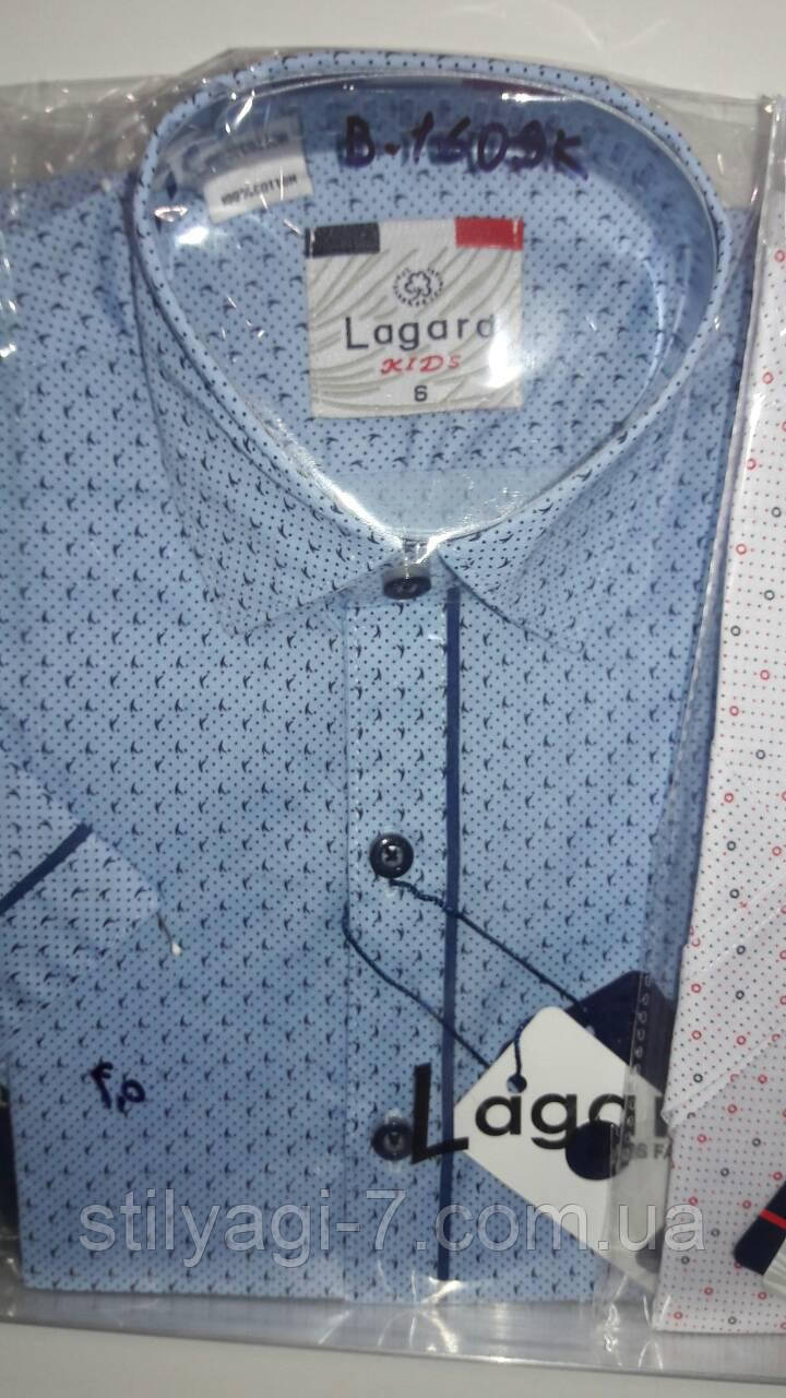 Рубашка на 7-12 лет с коротким рукавом голубого цвета с узором, оптом