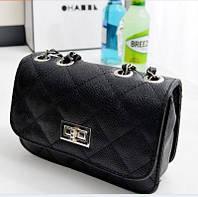 Женская сумочка в оригинальном дизайне