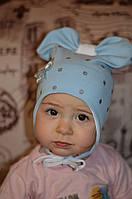Голубая детская шапочка с бантиком