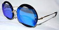 Женские солнцезащитные круглые очки с синей оправой