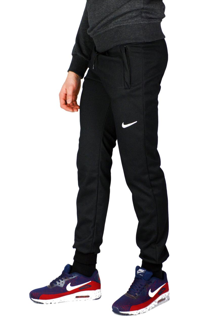 c2f0d992970 Черные мужские спортивные трикотажные штаны с манжетами NIKE ...