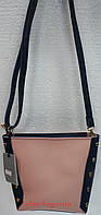 Маленькая женская сумка с заклепками