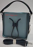 Маленькая женская  сумка  в сумке с затяжками