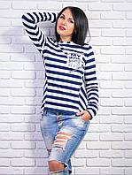 Модная полосатая кофточка с рисунком на кармане