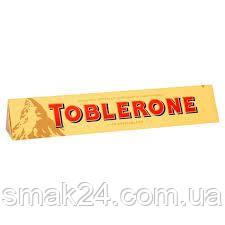 Швейцарский молочный шоколад Tobleron с медом и миндальной нугой 35г