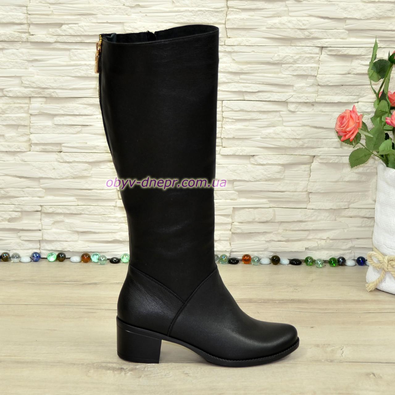 Женские кожаные сапоги демисезонные на устойчивом каблуке.