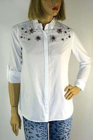 7ffb4c2ea9b087 Жіноча біла сорочка з вишивкою представлена в магазині жіночого ...