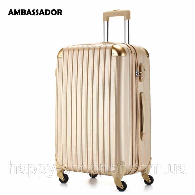 Большой золотистый чемодан Ambassador® Scallop