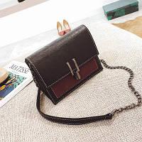 Жіноча сумочка маленька чорна через плече на металевій засувці