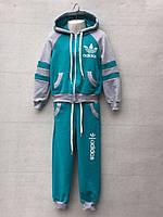 Спортивный костюм для девочки 4-7 лет бирюзового цвета Adidas с капюшоном оптом