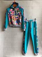 Спортивный костюм для девочки 8-11 лет бирюзового цвета Adidas с капюшоном с цветами оптом