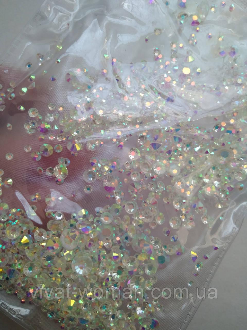 Клейові стрази Crystal AB мікс розмірів SS3-20. Ціна за упаковку 10г