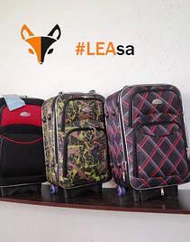 Дорожні валізи, сумки на коліщатках і рюкзаки