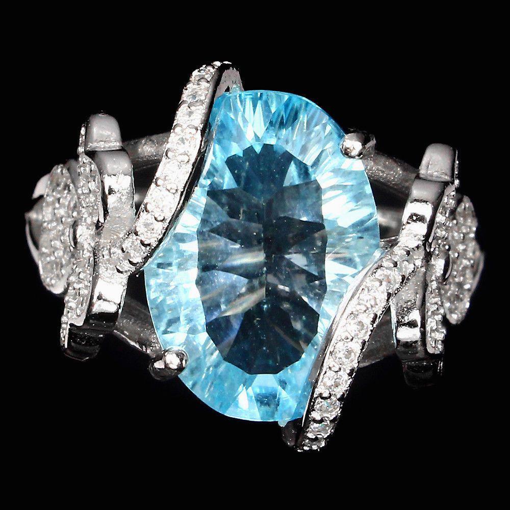 Кольцо с Топазом (Swiss Blue) и фианитами