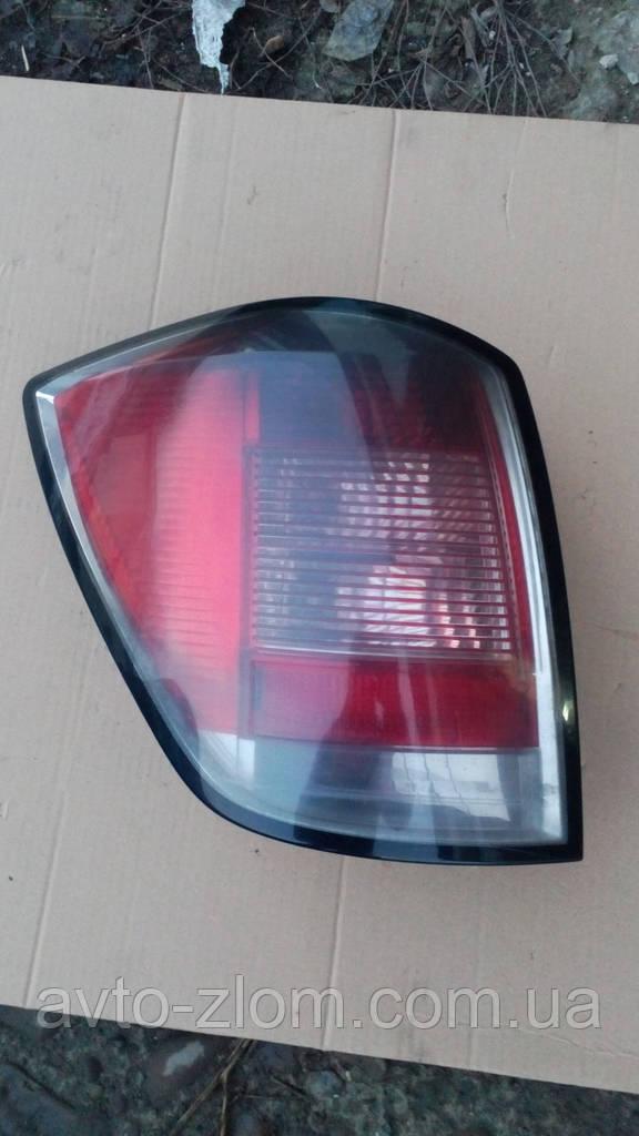 Задний левый фонарь Opel Astra H универсал.