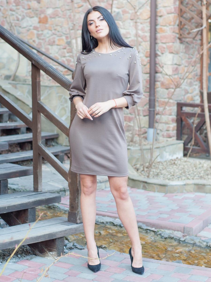 Женское платье по колено