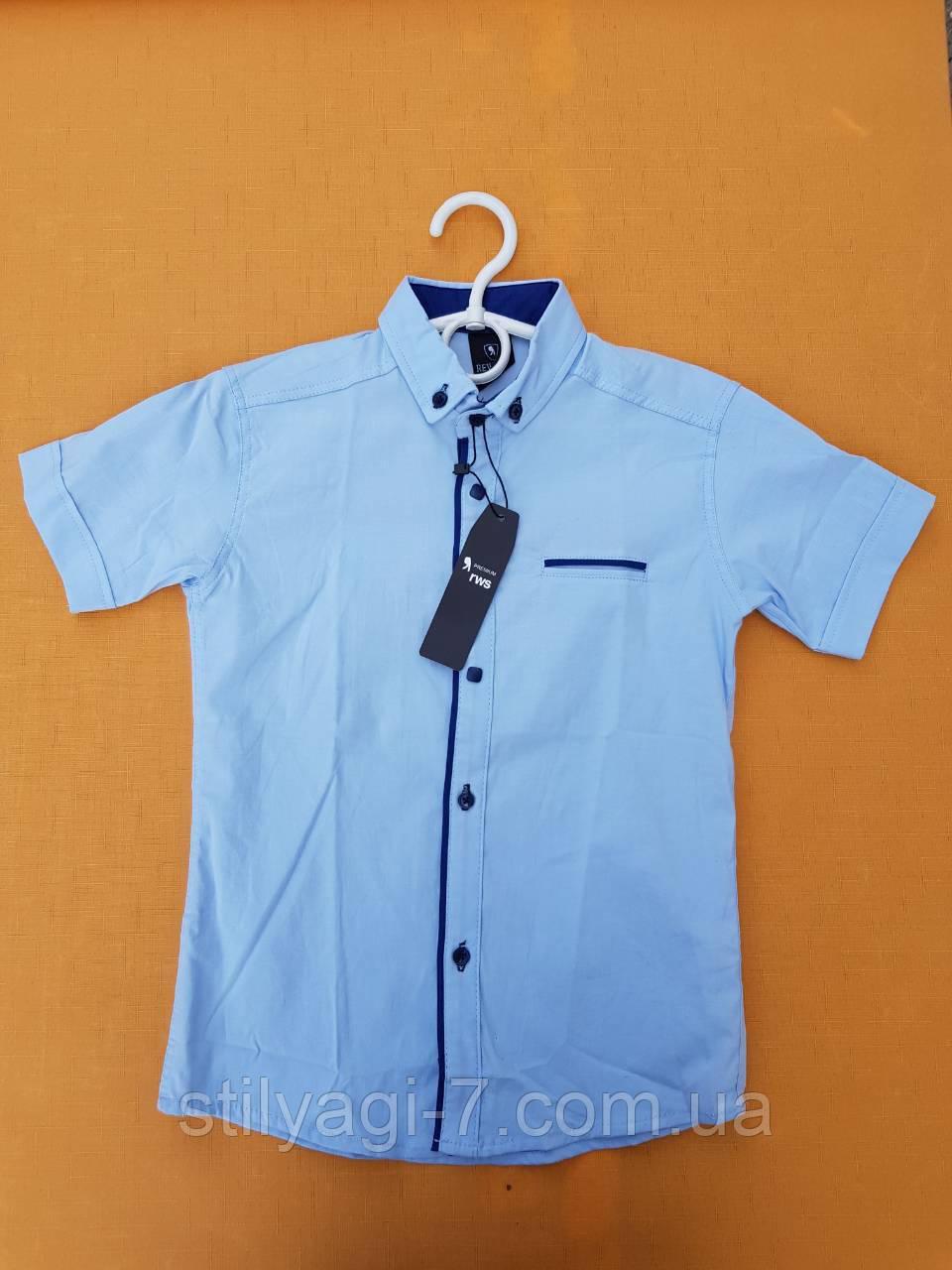 Рубашка на мальчика 12-16 лет голубого цвета с синей окантовкой оптом