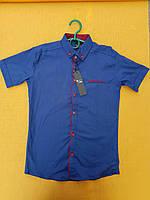 Рубашка на мальчика 6-11 лет темно синего цвета с красной окантовкой оптом