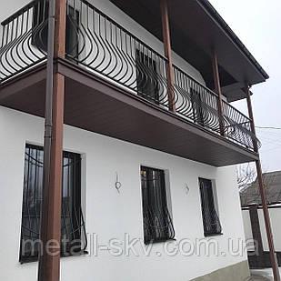 Кованый металлический балкон