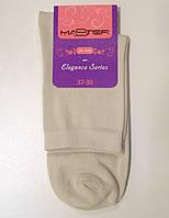 Носки женские высокие бежевого цвета
