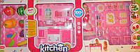 Кухня со столом, куклой, овощами