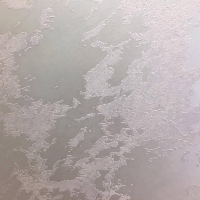 Штукатурка с эффектом песка на стенах