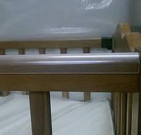 Накладка-грызунок на детскую кроватку.