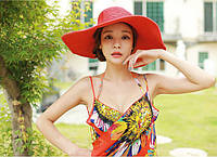 Женская шляпа с широкими полями