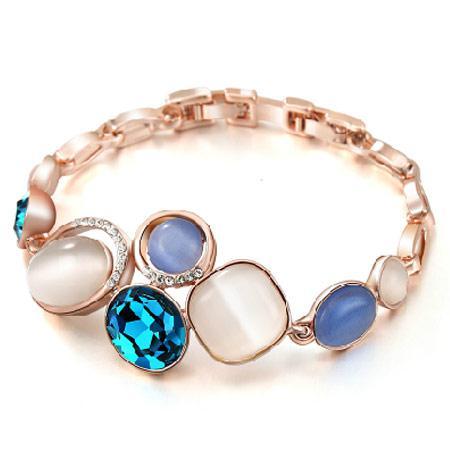 Браслет на цепочке с голубыми камнями под золото B006490