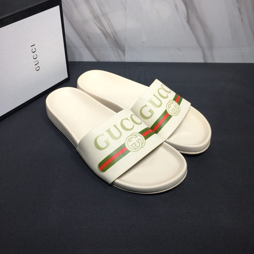 Шлепанцы белые Gucci